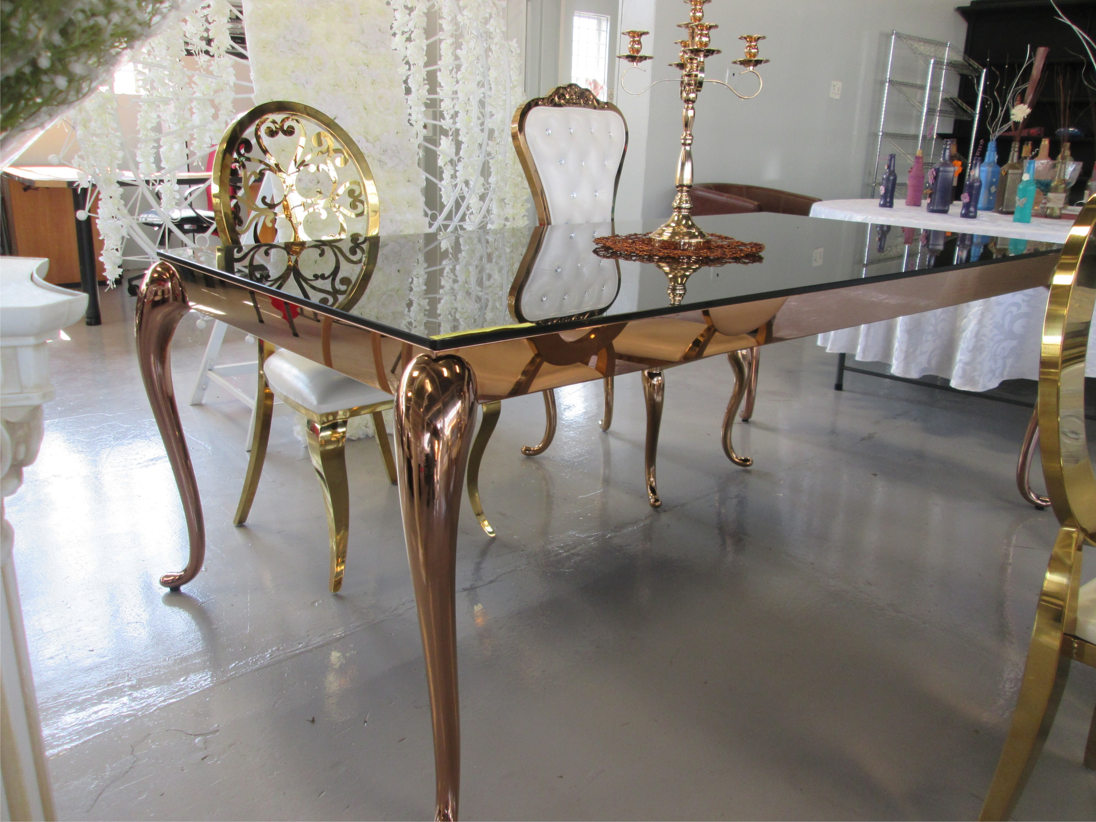2M X 1M STAINLESS STEEL ROSE GOLD TABLE WITH BLACK REFLECTIVE GLASS TOP